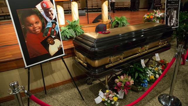 Brown's body lay in a black and gold casket in Friendly Temple Missionary Baptist Church