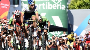 Australian rider Michael Matthews of Orica GreenEdge reacts as he crosses the finish line just ahead of Dan Martin