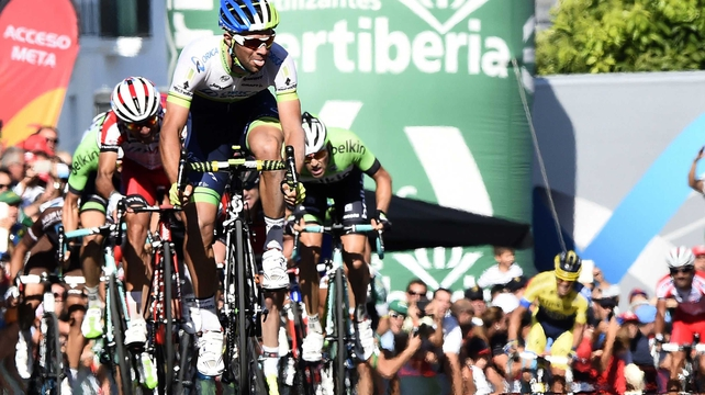 Australian rider Michael Matthews of Orica GreenEdge reacts as he crosses the finish line just ahead of Dan Martin