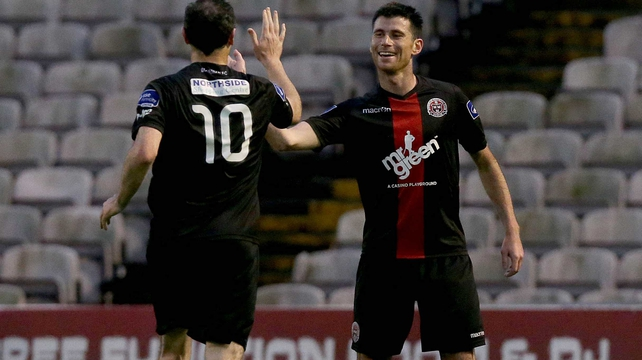 Dinny Corcoran celebrates scoring the only goal of the game with Jason Byrne