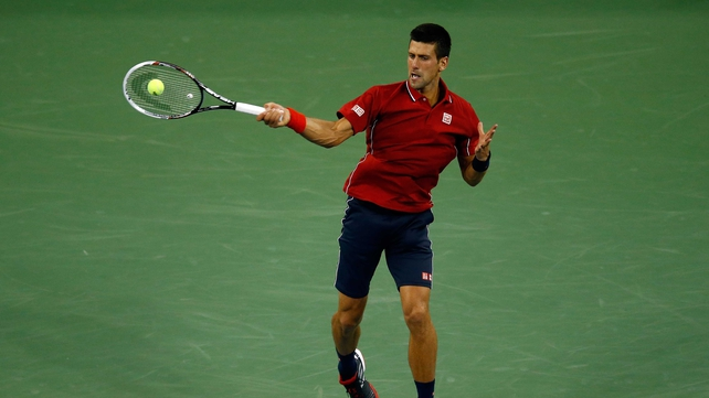 Novak Djokovic returns against Diego Schwartzman