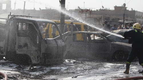 A car bomb ripped through a crowded Baghdad intersection during morning rush hour