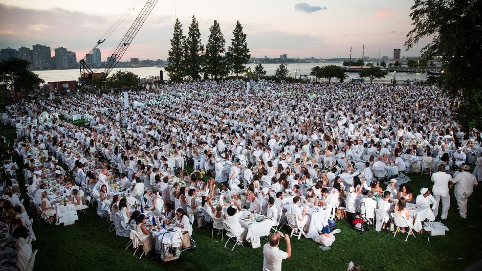 People attend the annual 'Diner en Blanc' in the Battery Park neighbourhood of New York City