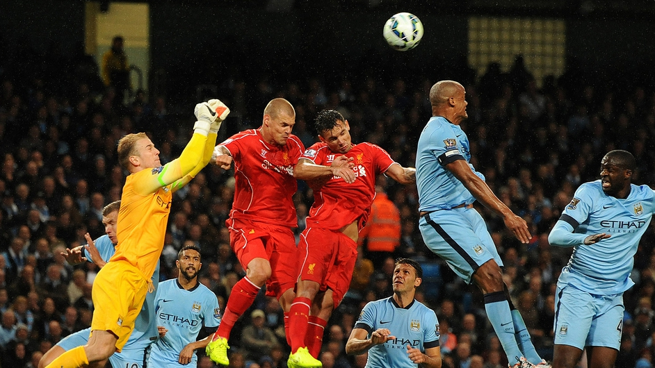 Man City goalkeeper Joe Hart challenges for the ball during the Premier League clash with Liverpool