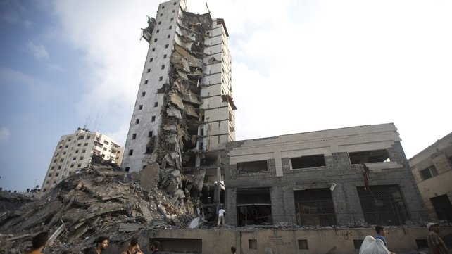 Israeli air strikes destroyed much of one of Gaza's tallest apartment and office buildings