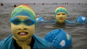 Chinese women wear 'face-kinis' while swimming in the Yellow  Sea in Qindao to protect them