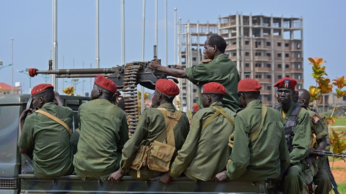 South Sudanese soldiers secure a road near the airport in Juba, South Sudan's capital