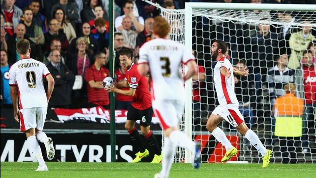 Will Grigg of Milton Keynes Dons celebrates scoring the opening goal
