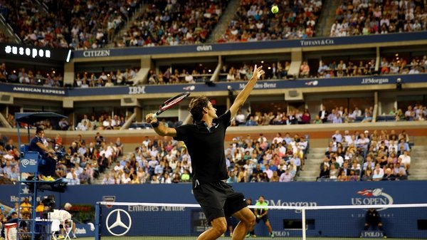 Roger Federer of Switzerland serves against Marinko Matosevic