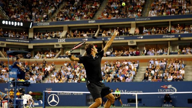 Roger Federer of Switzerland serves against Marinko Matosevic