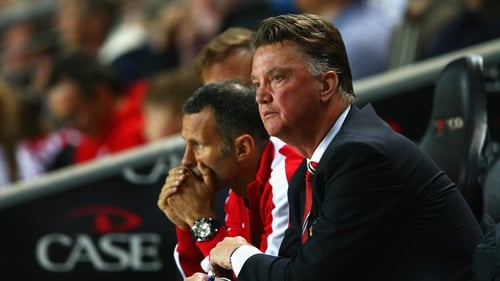 Louis van Gaal and his assistant manager Ryan Giggs look in in dismay as United are humbled by MK Dons