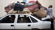 A Palestinian family prepares to return home from the UN school in Gaza City following the ceasefire