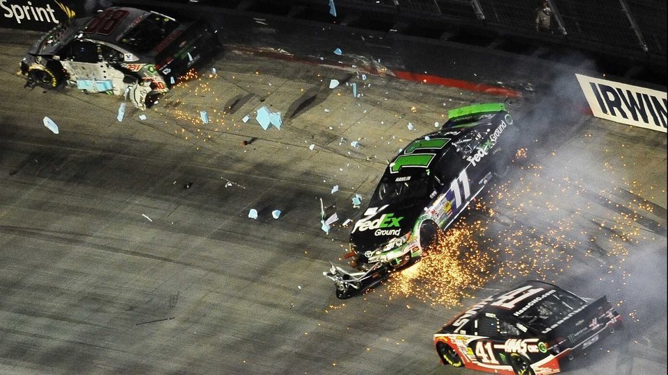 A three-way crash at the NASCAR Sprint Cup Series Irwin Tools Night Race at Bristol Motor Speedway, Tennessee