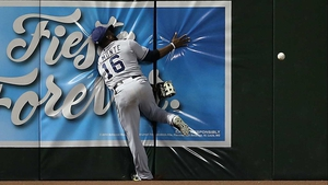 Abraham Almonte of the San Diego Padres crashes into the wall during the MLB game at Chase Field in Phoenix, Arizona