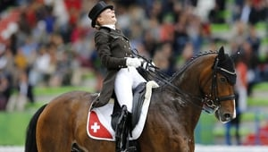 German rider Fabienne Lutkemeier on horse D'agostino FRH competes in the Grand prix special Dressage competition during the World Equestrian Games 2014 in Caen, France