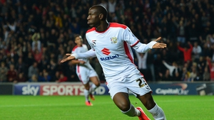 Benik Afobe of MK Dons celebrates scoring his side's third goal in a 4-0 victory over Manchester United