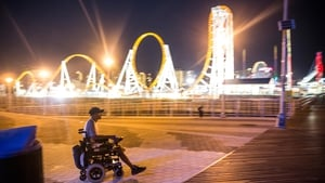 A man in an electric wheel chair crossed the boardwalk in Coney Island, New York