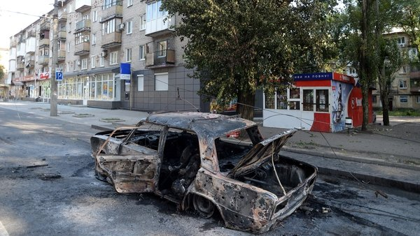Shelling in Donetsk brought down a tram cable, sitting this car alight and killing three people