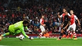 Nervy Arsenal edge to Champions League win