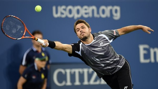 Stan Wawrinka stretches for a ball against Thomaz Bellucci