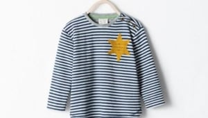 The striped top featured a golden six-pointed star stitched onto the upper left hand side