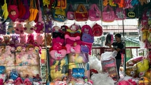 A Filipino vendor sells stuffed toys at a store in Manila, Philippines