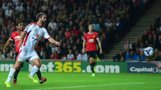 Will Grigg scores against United