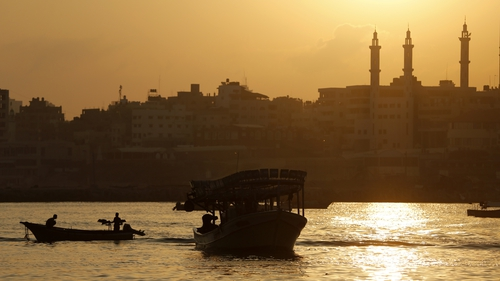Palestinian fishermen sail their boats at Gaza's seaport in Gaza City
