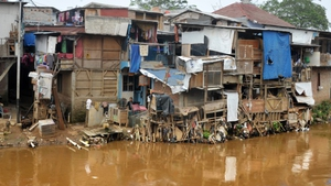 Shanty houses are seen a long the river at downtown Jakarta