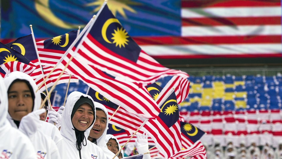 Malaysian students performs during the Malaysia's Independence Day rehearsal celebrations in Kuala Lumpur