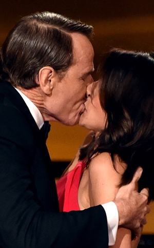 Bryan Cranston gives Julia Louis-Dreyfus oral root canal treatment at the Emmys