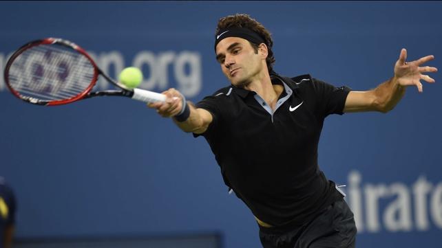 Roger Federer's returns a rocket serve from Sam Groth