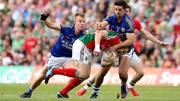 Kerry's Aidan O'Mahony and Fionn Fitzgerald tackle Andy Moran