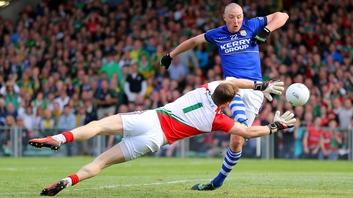 Kerry's Kieran Donaghy scores a goal past Mayo goalkeeper Robert Hennelly
