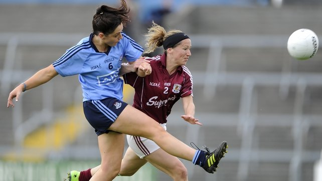 Dublin's Sinead Goldrick scores a point despite the effort of Noelle Connolly of Galway
