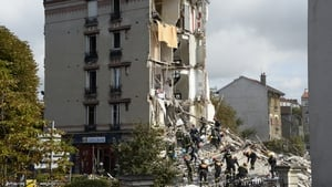 People were evacuated from the rubble of the building in a Paris suburb