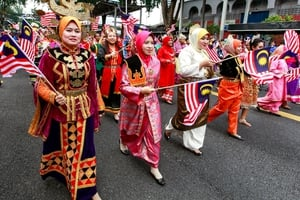 Participants dressed in ethnic traditional costumes parade during the Independence Day celebrations in Kuala Lumpur, Malaysia