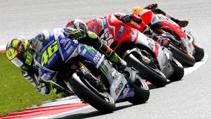 Valentino Rossi leads Dani Pedrosa and Andrea Dovizioso during a MotoGP race at Silverstone