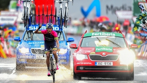 Winner Anacona punches the air as he comes home in splendid isolation on stage nine of the Vuelta