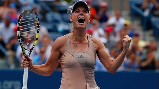 Caroline Wozniacki celebrates one of her biggest wins in recent years