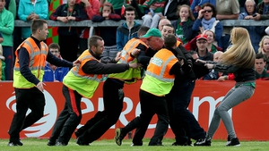 One Mayo fan was particularly unimpressed with the officials and was invited to leave the pitch by the stewards