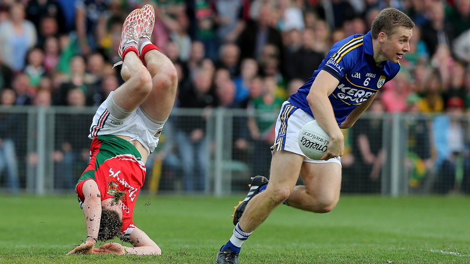 Head over heels - Lee Keegan of Mayo with Peter Crowley of Kerry during the Kingdom's semi-final victory in Limerick