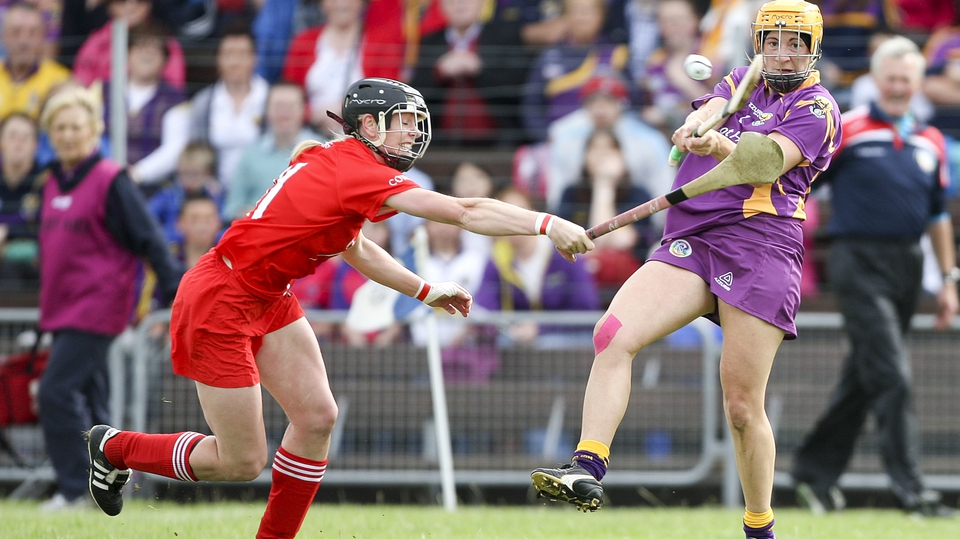 Wexford's Deirdre Codd clears the sliotar as Angela Walsh of Cork closes in during the Rebelettes' All-Ireland semi-final victory