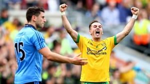 Donegal's Karl Lacey celebrates at the final whistle, while Bernard Brogan looks on, dejected