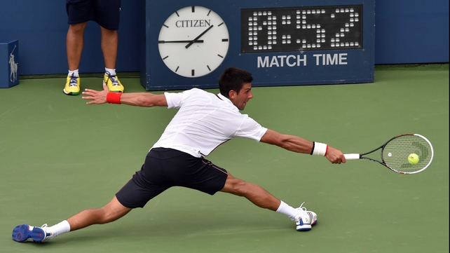 Novak Djokovic shows off his legendary defensive qualities with a lunging return at Flushing Meadows