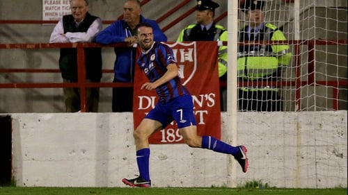 Conan Byrne wheels away after scoring the only goal of the game at Tolka Park