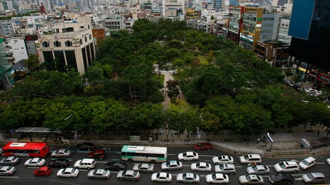 Traffic builds up in front of a small park in downtown Daegu in South Korea
