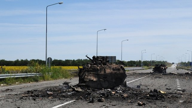 A destroyed armoured vehicle on the road of the airport in the south of Luhansk