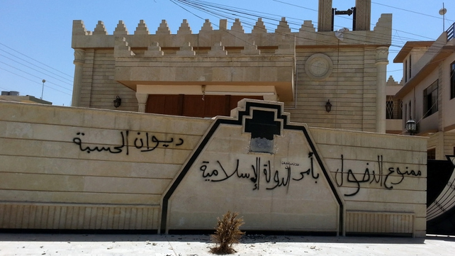 'No Entry by order of the Islamic State' is written in Arabic on the walls of an empty Christian church in Mosul