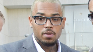 Chris Brown leaving court in Washington today